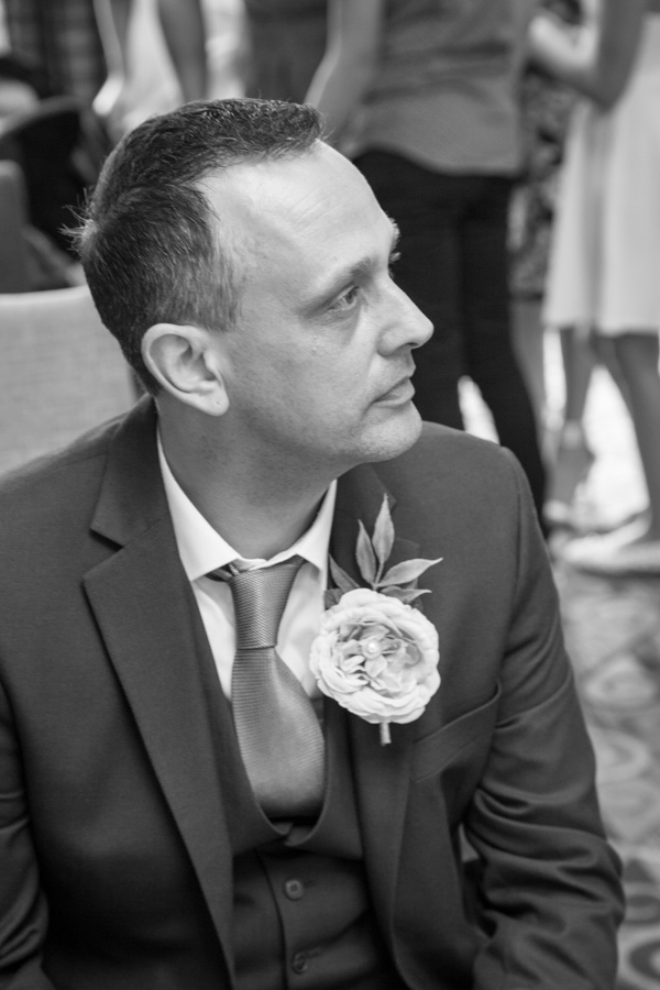 Groom waiting in the ceremony room at Tankersley Manor Hotel