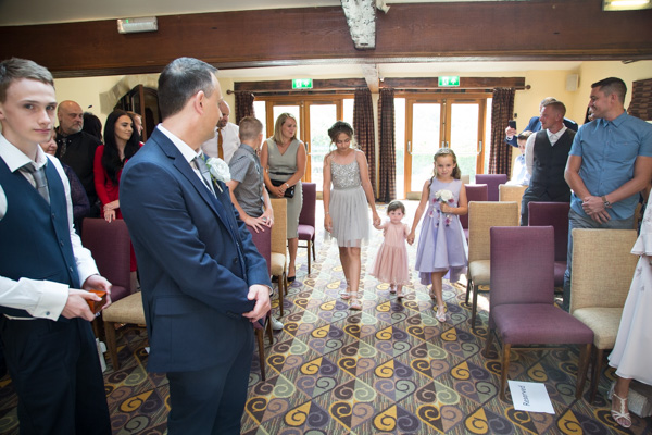 Bridesmaids walking down the aisle at Tankersley Manor Wedding
