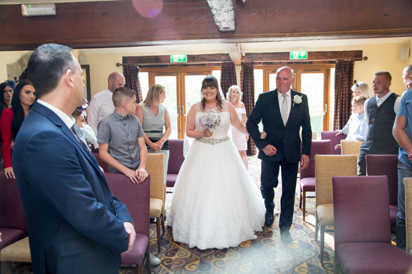 Bride and Father of the bride walking down the aisle at Tankersley Manor Wedding