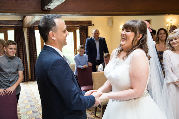 Bride and groom laughing at the altar at Tankersley Manor Wedding