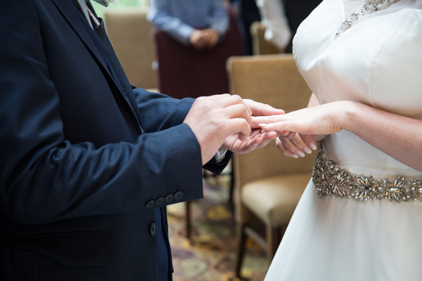 Bride and Groom exchange wedding rings at Tankersley Manor Wedding
