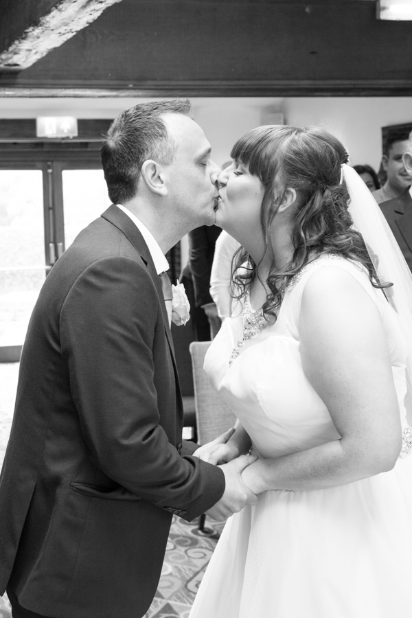 Bride and Groom kiss at Tankersley Manor Wedding Barnsley