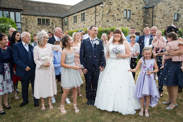 Wedding guests throwing confetti at Tankersley Manor Wedding