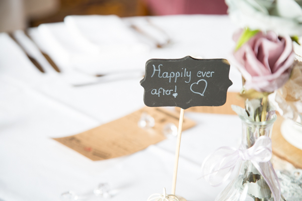 Happily ever After sign on the top table
