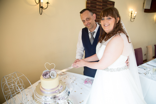 Bride and Groom cutting the cake at Tankersley Manor Wedding
