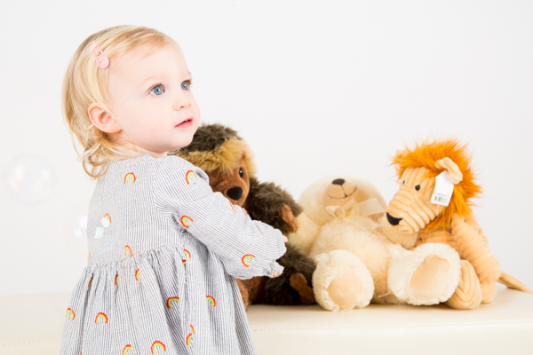 Girl playing with teddy bears in Barnsley photography studio