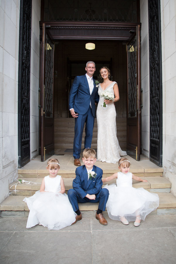 Bride and Groom on the steps of Barnsley Town Hall wedding with their children Wedding Photographer Barnsley