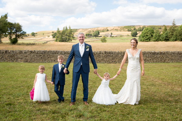 Bride and Groom with their children in the garden of a Barnsley wedding Photography