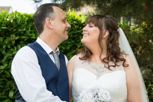 Couple smiling at each other during Tankersley Manor Wedding Wedding Photographer Barnsley