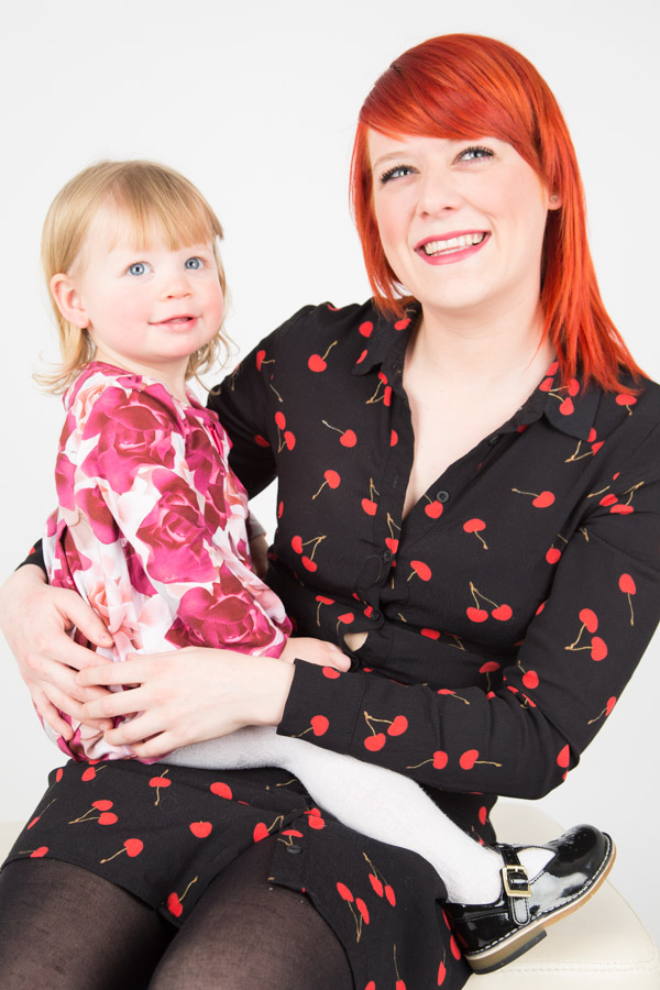 Lady with red hair holding her baby during a Barnlsey Studio Session