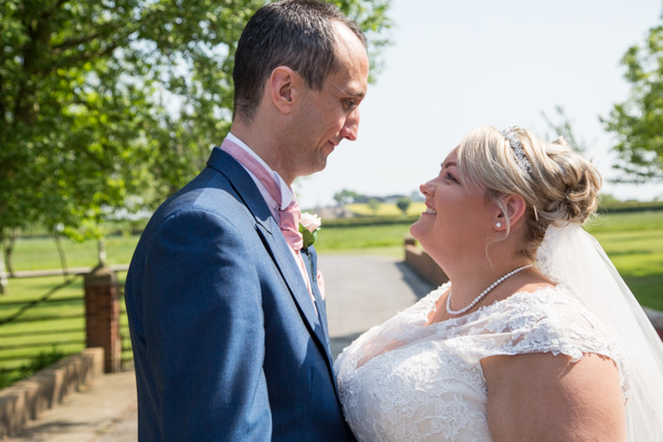 Bride and Groom looking at each other at Burntwood Court Hotel Wedding