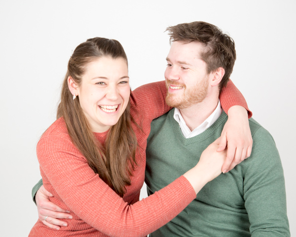 Couple holding each other and laughing during a family photography session barnsley