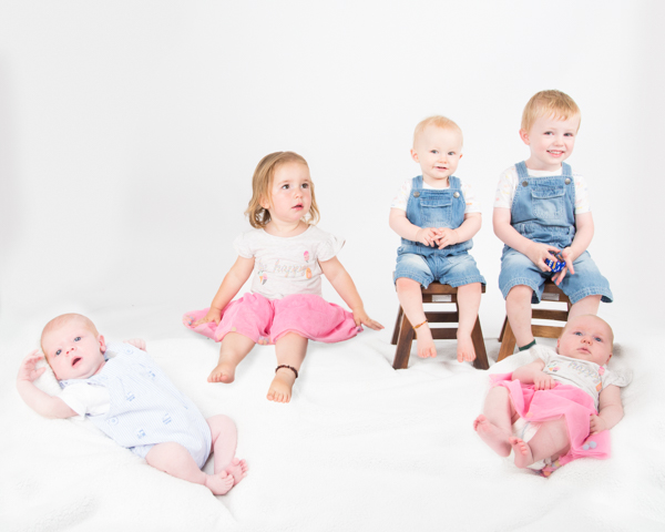 babies and toddlers sitting together during a family photography session Barnsley