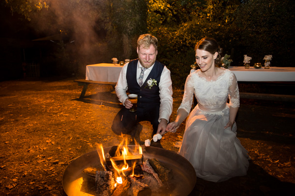 Bride and toasting marshmallows at the Rockingham Arms Wentworth on their wedding day