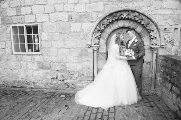 Bride and Groom looking at each other at Priory Barn and Cottages Wedding