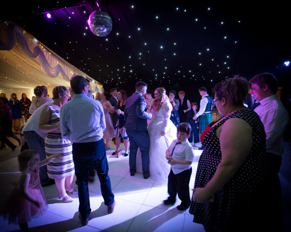 Couple looking at each other on the dance floor at Priory Barn and Cottages Wedding