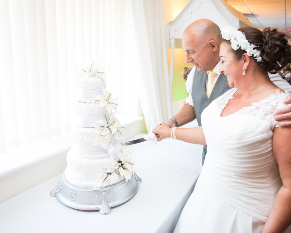 Bride and Groom cutting cake at Shaw Lane Sports Club Wedding