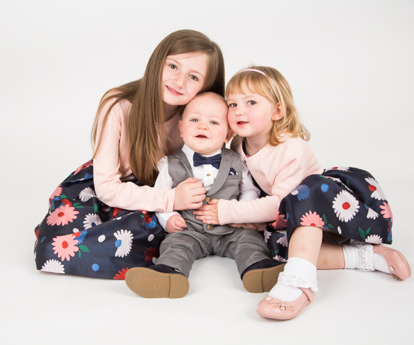Two girls cuddling their Brother during Barnlsey photography session