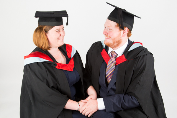 Couple who have just graduated during a studio session