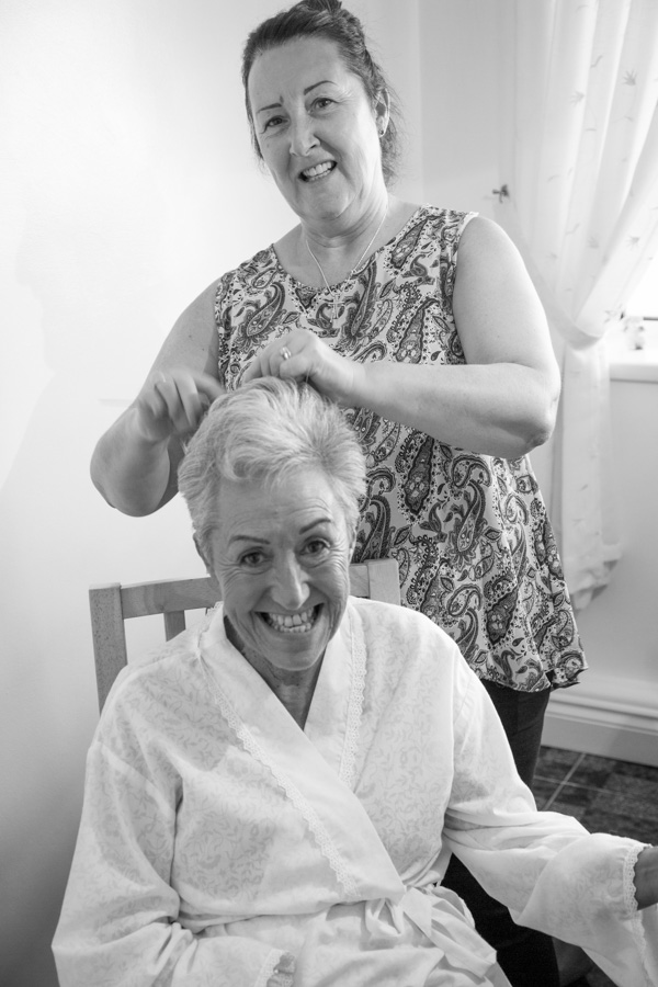 Mother of the bride having her hair and makeup done