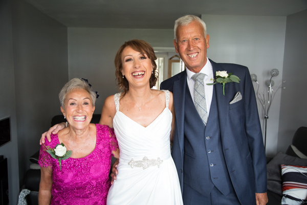 The bride and her parents before the ceremony