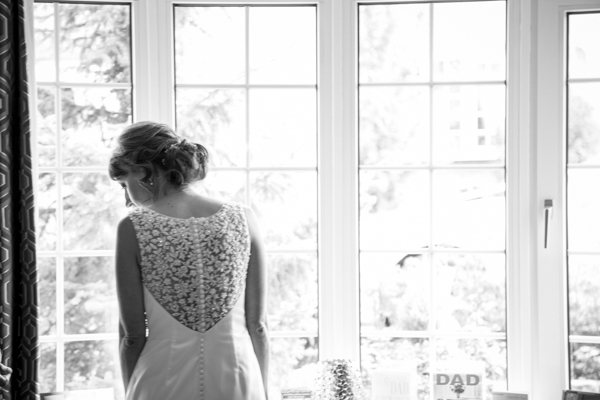 Bride looking out of her window before her wedding