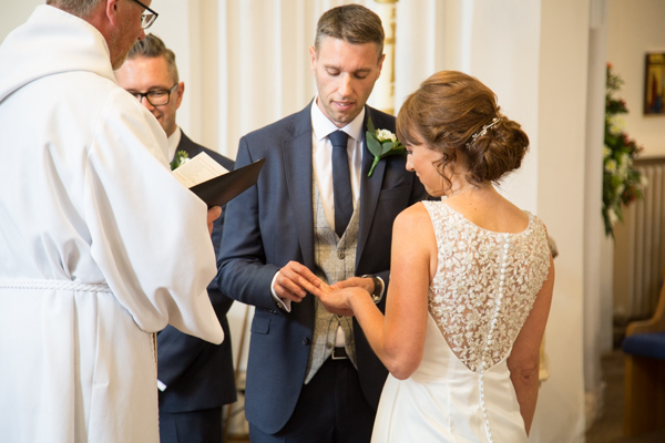 Bride and Groom exchange wedding rings at All Saints Church Pontefract Wedding