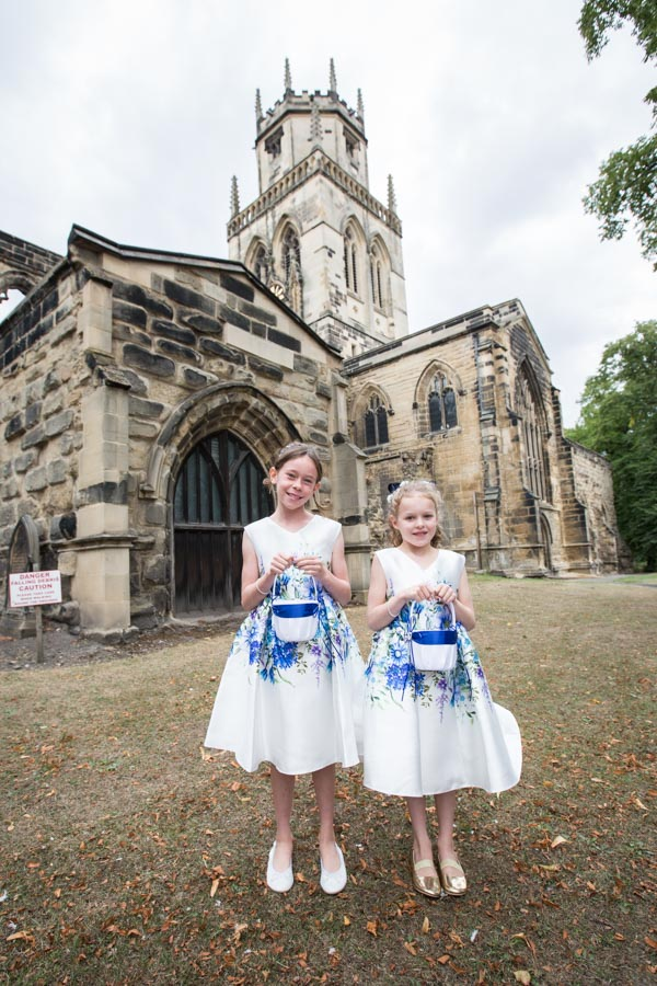 Flowergirls in blue and white dresses outside All Saints Church Pontefract width=