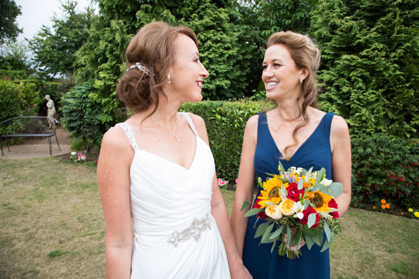 Bride laughing with her sister at Rogerthorpe Manor Wedding