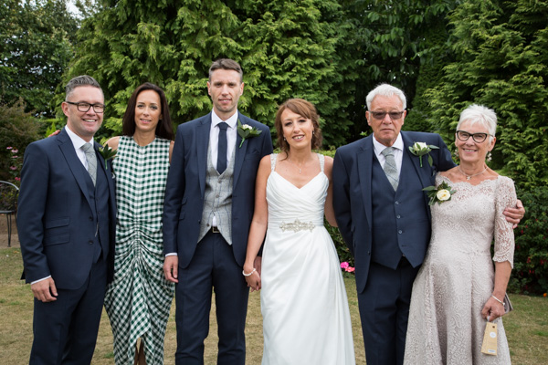 Bride and Groom with their family at Rogerthorpe Manor Wedding