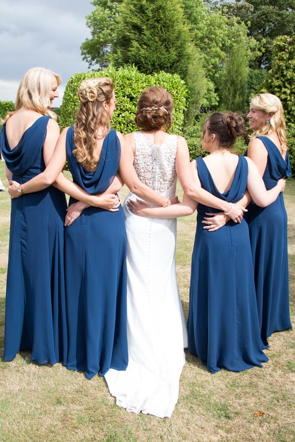 The back of the bridesmaid dresses and bridal gown