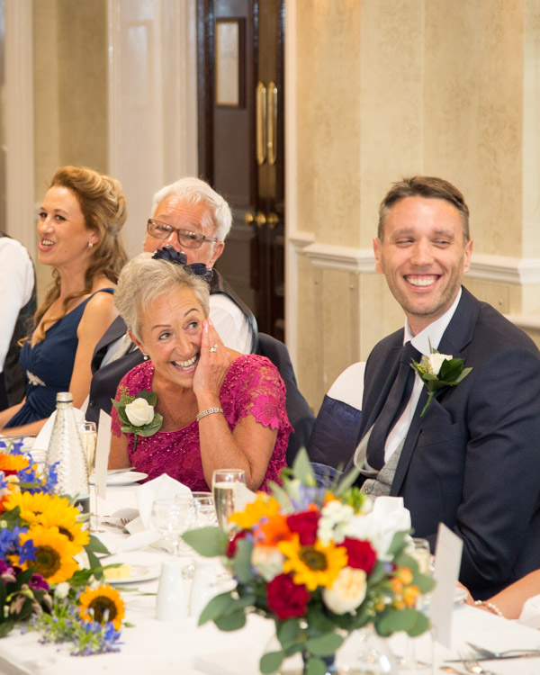 Guests laughing during speeches at Rogerthorpe Manor Wedding