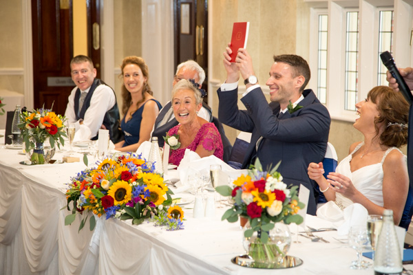 Top table laughing during speeches at Rogerthorpe Manor Wedding