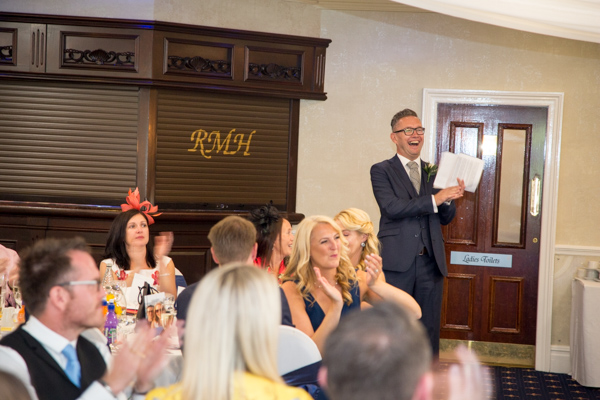 Best man laughing during speeches at Rogerthorpe Manor Wedding