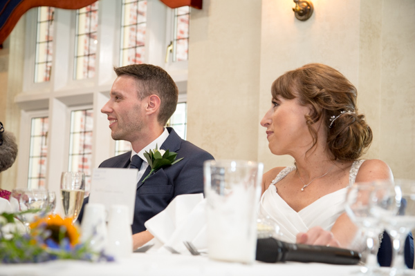 Bride and Groom laughing during speeches at Rogerthorpe Manor Wedding