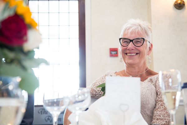Mother of the Groom laughing at Rogerthorpe Manor Wedding