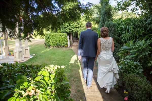 Bride and Groom walking through the grounds at Rogerthorpe Manor Wedding