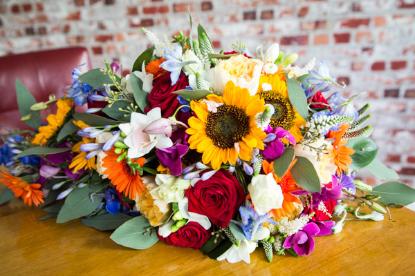 The bridal bouquet by passion flowers with roses and sunflowers