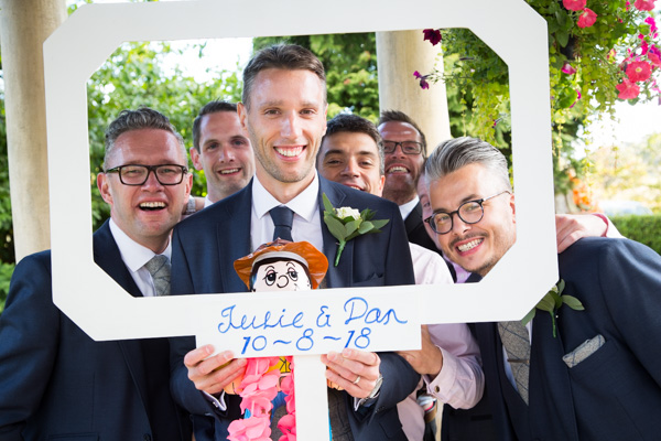 Guests in DIY photo booth at Rogerthorpe Manor Wedding
