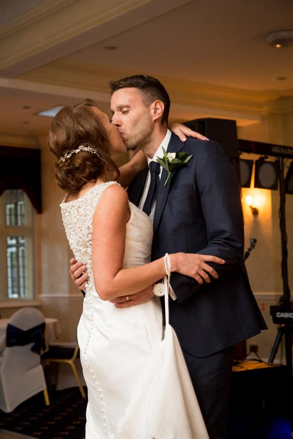 Bride and groom kiss on the dance floor at Rogerthorpe Manor Wedding