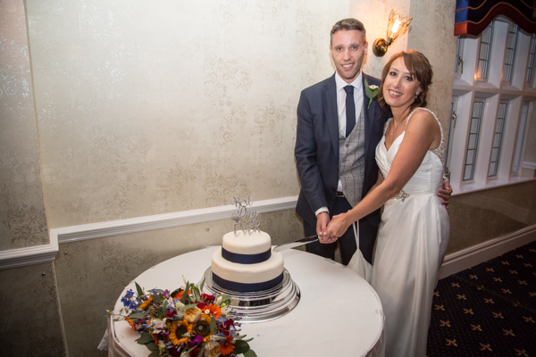 Bride and Groom cutting the cake at Rogerthorpe Manor Wedding