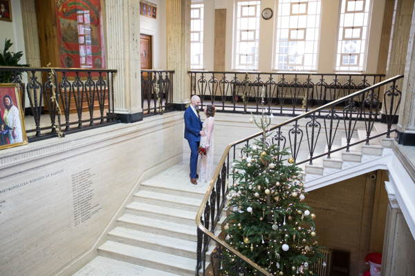 Bride and groom on the stairs at Barnsley Town Hall Wedding