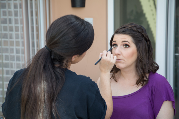Bridesmaid having her makeup done on the morning of the wedding