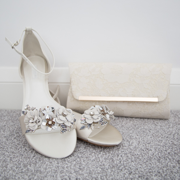 Bridal shoes and bag with flower and diamante detail