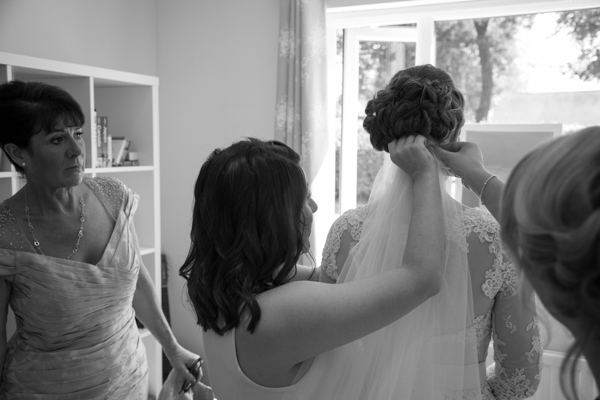 The bridal party putting in the brides veil