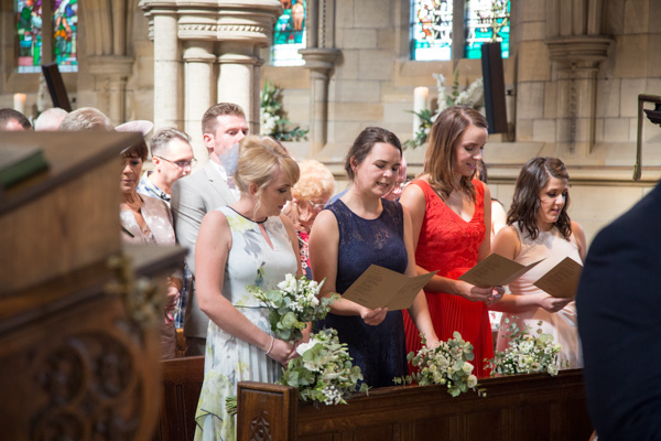 Bridesmaids singing a hymn at Wentworth church wedding