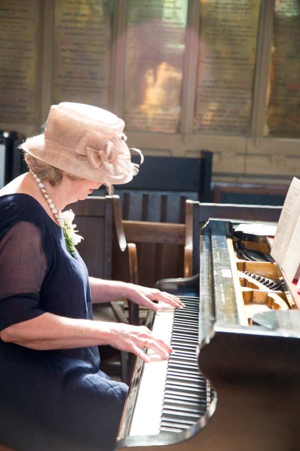 Mother of the Groom playing the piano during Wentworth Church Wedding