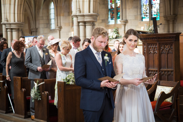 Bride and Groom singing Hymns during Wentworth Church Wedding