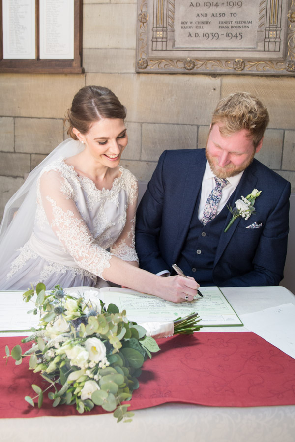 Bride and Groom signing the register at Wentworth Church Wedding