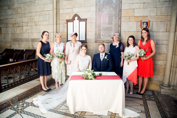 The bridal Party with the register at Wentworth church Wedding